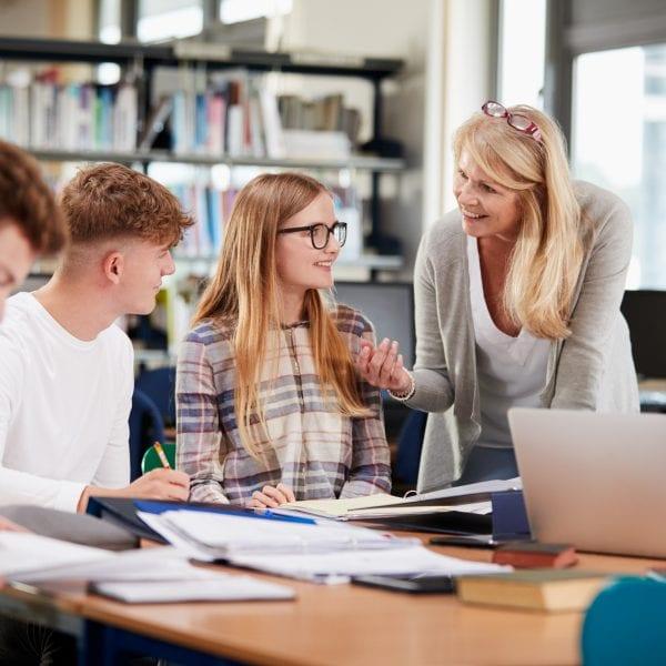 teacher speaking with pupil
